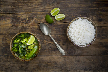 Green thai curry with broccoli, pak choi, snow peas, baby spinach, lime and bowl of rice - LVF06975