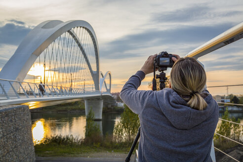 France, Alsace, Strasbourg, Passerelle des Deux Rives at sunset, female photographer in the foreground - JUNF01042