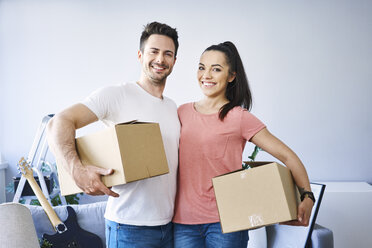Portrait of happy couple moving in - BSZF00396