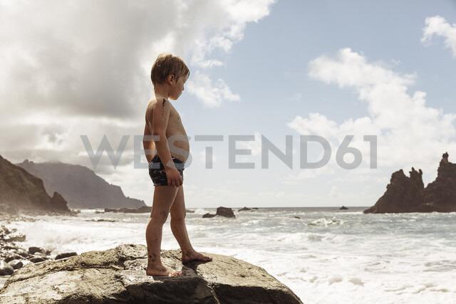 Young boy standing on rock, looking at view, Santa Cruz de Tenerife, Canary Islands, Spain, Europe - CUF07238 - Igor Emmerich/Westend61