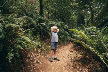Boy in forest looking at camera smiling, Fairfax, California, USA, North America - CUF07265