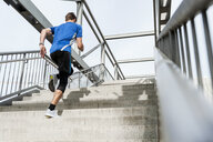 Man running up stairs - DIGF04243