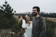 Happy couple in countryside, Whitby, Ontario, Canada - ISF01578