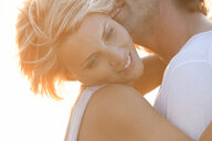 Couple hugging - CUF07939