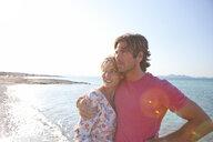 Couple hugging on beach - CUF07945