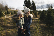 Mother and baby girl in Christmas tree farm, Cobourg, Ontario, Canada - ISF01826