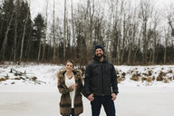 Happy couple on frozen lake, Whitby, Ontario, Canada - ISF01838