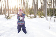 Girl playing with snow, Peterborough, Ontario - ISF02051