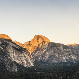 Elevated view of valley forest and mountains at sunset, Yosemite National Park, California, USA - CUF07995