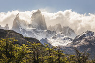 Low cloud over sunlit  Fitz Roy mountain range in Los Glaciares National Park, Patagonia, Argentina - CUF08037