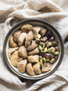 Dried fruit and mixed nuts in bowl, close-up - CUF08826