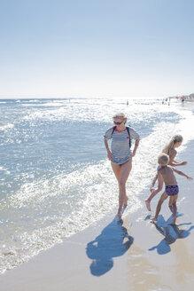 Poland, Gdansk Bay, woman strolling on the beach - HAM00269