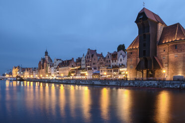 Poland, Gdansk, lighted promenade with Crane Gate and Motlawa river at blue hour - HAMF00275