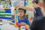 Boys stacking building blocks in kindergarten - ZEF15433
