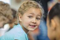Portrait of smiling girl in kindergarten - ZEF15439