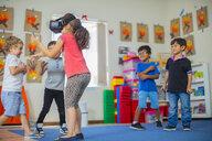 Children with VR glasses playing in kindergarten - ZEF15460