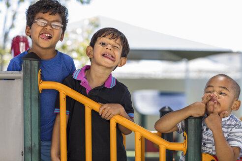 Portrait of playful boys grimacing in kindergarten - ZEF15469