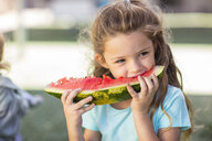 Girl eating a watermelon in kindergarten - ZEF15475