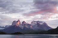 South America, Chile, Patagonia, Torres del Paine National Park, Cuernos del Paine from Lake Pehoe at sunrise - CVF00529