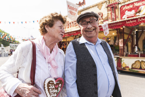 Senior couple having fun on fair - UUF13758