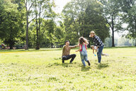 Active happy family in a park - UUF13767