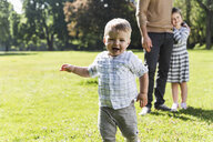 Happy boy with family in a park - UUF13797