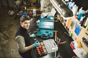 Portrait of a confident mechanic in his workshop - RAEF02039