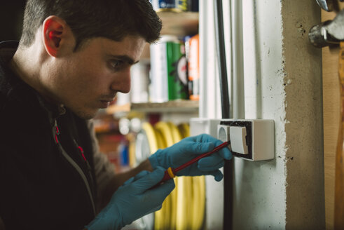 Man working on an electrical installation - RAEF02048