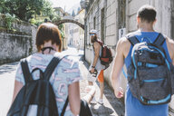 Three young hipster friends strolling along street, Como, Lombardy, Italy - CUF09341