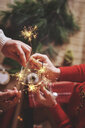 Couple holding indoor sparklers - CUF09641