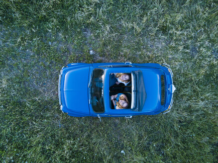 Overhead view of friends in convertible car looking up, Firenze, Toscana, Italy, Europe - CUF09677
