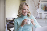 Smiling mature woman drinking coffee - HOXF03529