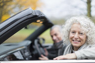 Portrait smiling senior couple in convertible - CAIF20518