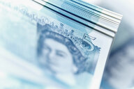 Close up five pound note stack - CAIF20542