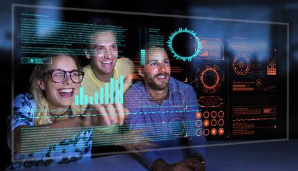 Enthusiastic business people using futuristic hologram computer - CAIF20623