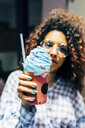 Woman enjoying icy drink - CUF10057