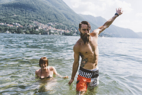 Portrait of young hipster couple in lake Como, Como, Lombardy, Italy - CUF10090
