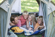 Family camping in tent - CUF10144