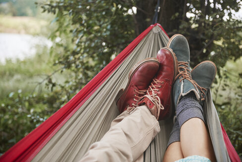 Feet of couple relaxing in hammock, Krakow, Malopolskie, Poland, Europe - CUF10484