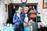 Couple in vintage clothes in quirky hair salon - CUF10875