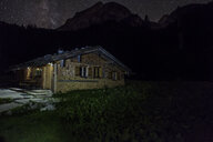 Germany, Bavaria, Berchtesgaden Alps, Wasseralm, wooden hut, milky way at night - HAMF00302
