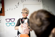 Woman working in quirky hair salon - CUF10970