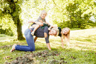Mother and daughters enjoying park - CUF11327