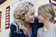 Mother and daughter enjoying being together outdoors - CUF11402