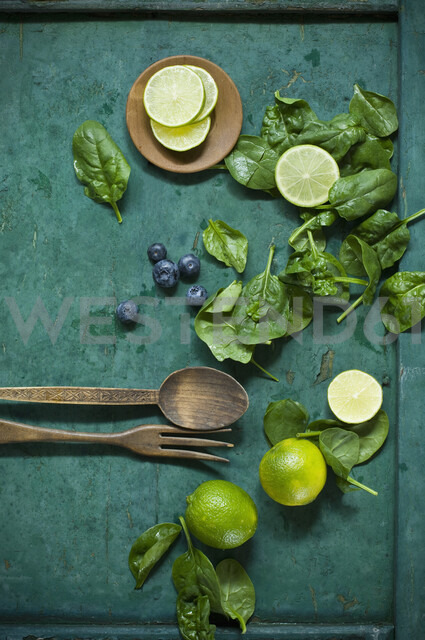 Salad ingredients and salad cutlery on green ground - ASF06185