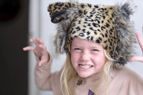 Portrait of little girl wearing plush cap with leopard print - HAMF00317