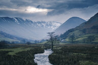 Storm clouds over snow capped mountains at Martindale, The Lake District, UK - CUF11675