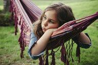 Portrait of sad girl lying in hammock - ANHF00053