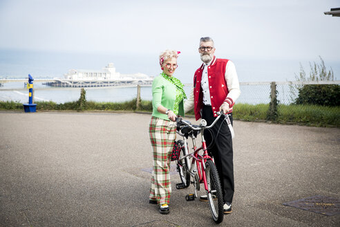 Portrait of 1950's vintage style couple with tandem bicycle at coast - CUF12106
