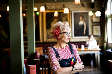 Quirky woman in bar and restaurant, Bournemouth, England - CUF12364